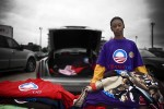 Kevin, 16 years old, drove from Gary, Indiana to Minneapolis to sell Barack Obama t-shirts. While clearly profiting from his speech, Kevin also expressed a desire to be involved in this historic election and claims that selling these shirts is the only way he can afford to travel in hopes of seeing and hearing the Senator.