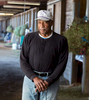 """Junior Coffey, 76, former UW football star from the 1960s, has been a horse racing trainer at Emerald Downs in Auburn, WA since the 1970s. Coffey grew up in the 1950s in the little town of Dimmit, Texas, where he was the first black player on his high school football team. He was so good -- and inspirational -- that a former teammate once told a reporter, """"he was sort of the Jackie Robinson of the area."""""""