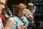Annie, center, and Jeff Shiffer, right, from Spokane, WA., follow instructions to sniff the sample wines at Chateau Ste. Michelle winery on September 17, 2007 in Woodinville, WA.