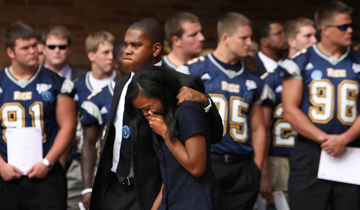 Carissa Jones and Gary Blackmon leave funeral services on October 1, 2006 for Rice University football player Dale Lloyd II, a 2006 graduate of Lamar High School, who passed away after collapsing during a workout at the university.