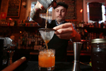 Roy H. Clark, head bartender at The Haberdasher, mixes a sweet tea cocktail in Mobile, Ala., on August 4, 2014.