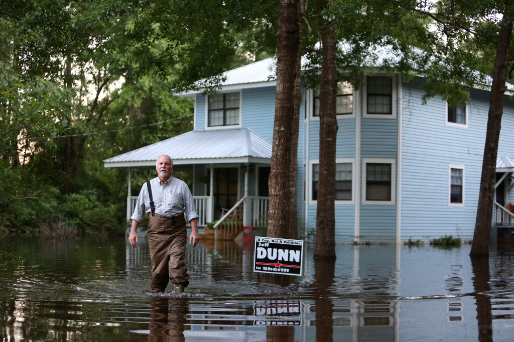 Keith Griffin must still wade in and out of his home along US 90 in Seminole, Ala., on Monday, May 5, 2014. Several houses in Seminole are still surrounded by floodwater a week after heavy rain.