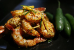Mustard steamed shrimp prepared by Indian chef Suneeta Vaswani in her home on Monday, Sept. 10, 2007, in Houston. ( Sharon Steinmann / Chronicle ).