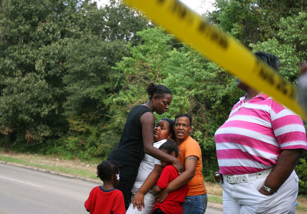 The family of 29-year-old Raymond Smith, who was fatally shot by a Houston police officer, reacts at the scene in the Acres Homes neighborhood of Houston.