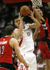 Yao Ming, center, of the Houston Rockets gains control of the ball against Toronto Raptors Rasho Nesterovic, left, and Kris Humphries, right, in the second quarter at the Toyota Center on Saturday, Dec. 29, 2007, in Houston. The Rockets won 91-79.