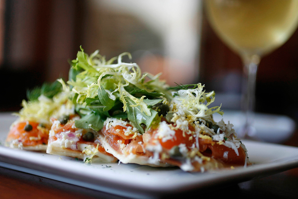 Smoked salmon pizzette with creme fraiche and arugula at Gravitas Restaurant in Houston, TX.