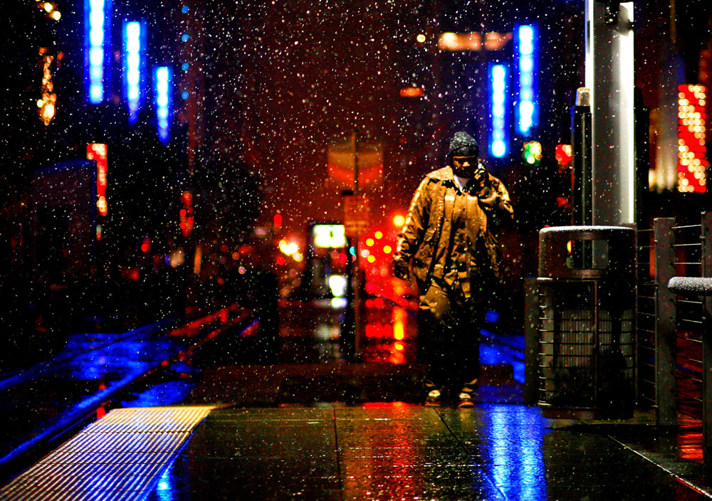 Tangela Jenkins walks to her metro train as a rare snowfall blankets downtown Houston.