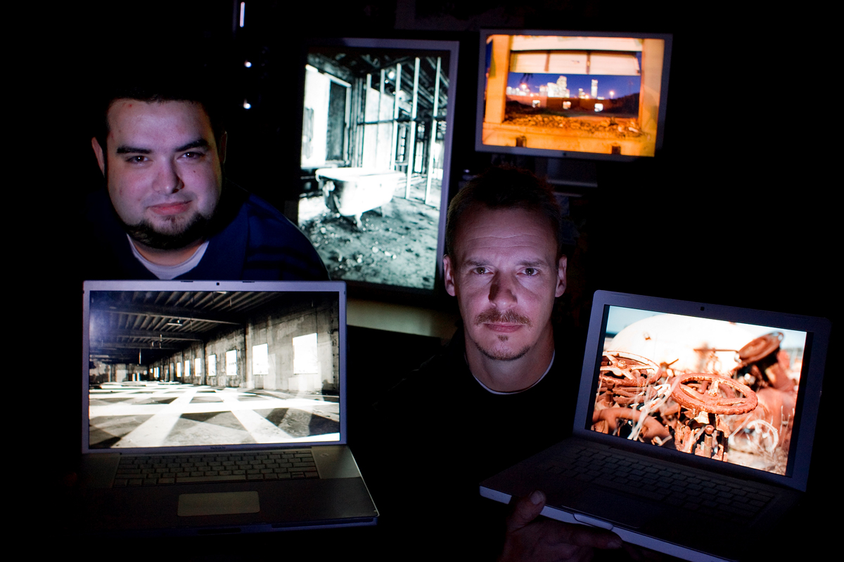 Alex Luster, left, and his brother Michael Luster pose in their studio with some of their photos from their architectural project {quote}Kinetic Decay{quote} displayed on computers.