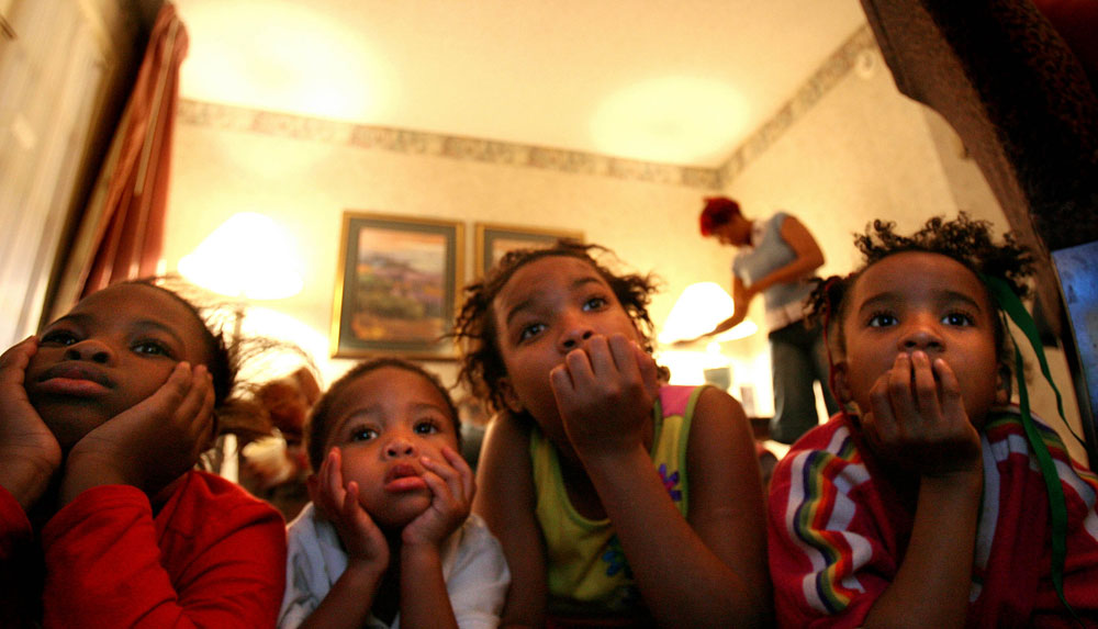 Shawn Powell's children and nieces and nephews watch television to pass the time in their hotel room at the Windsor Suites Hotel in Houston at the end of December 2005. From left are Sah Diamond Lee, 8, Myron Powell, 2, Brittany Powell, 13, and Brishawn Powell, 7.