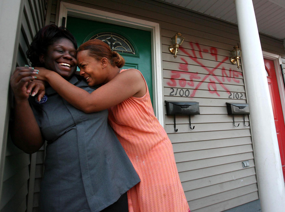 Shawn Powell, 32, right, hugs her best friend, Theresa Young, 28, in the seventh ward neighborhood of New Orleans where she found a section 8 duplex for her three daughters, two nieces and young nephew ranging from 2-years-old to 14 in March 2006. Theresa lived with her for a time. Powell had high hopes for a happy return to New Orleans from Houston but found her old neighborhood dangerous and unlivable.