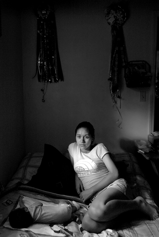 Maria takes advantage of nap time to watch television in her room decorated with her drill team mums from the last two school years. With Rocky working full-time, it was up to Maria to care for baby Rocky over the summer. Luckily, both grandmothers plan to babysit when she goes back to school.