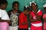 Brishawn Powell, 7, center, leans on a friend in the first few days day of school at Craig Elementary School in the sixth ward of New Orleans in mid-March 2006.