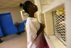Deiondrea Powell, 13, buys snacks in the corridor of the family dorm in June, 2006 at the Salvation Army homeless shelter in Austin.