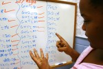 Brione Powell, 11, practices her multiplication in the family dorm computer lab at the Salvation Army homeless shelter in Austin in June 2006. Brione has learning disabilities and has not attended school for more than a two week stretch since Hurricane Katrina devastated New Orleans.