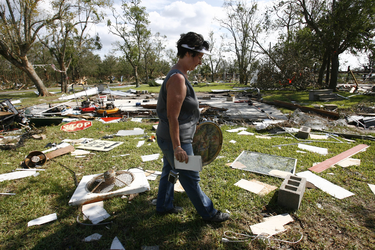 Linda McPike looks for her belongings in the remains of her home on Oak Island in Chambers County on Monday, Sept. 15, 2008.  She and her husband are not sure that they will rebuild.