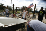 Michael Casonover's family salvages what they can from their home on Oak Island in Chambers County on Monday, Sept. 15, 2008.