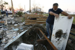 Steve Shiver looks at the rubble where their home once stood in Oak Island. They are living in a tug boat at Double Bayou in Oak Island after Hurricane Ike destroyed their home.  Steve operates the boats and his employer is keeping it docked as long as possible for the Shiver family.