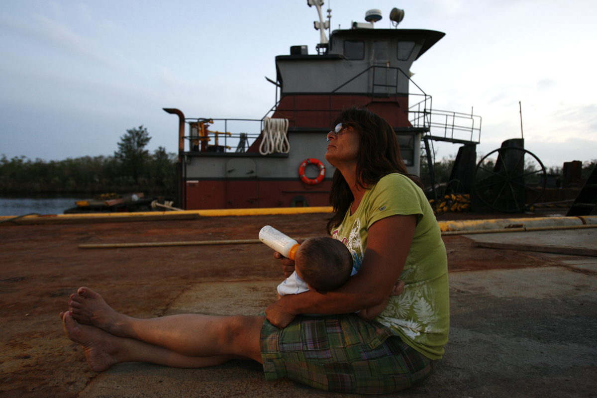 Margaret Shiver feeds her grandson DeWayn Eddings, four months, on the tug boat where she and her husband Steve Shiver are living since Hurricane Ike destroyed their home.