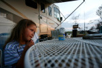 Zoe Key, 6, sits outside her RV in Oak Island.