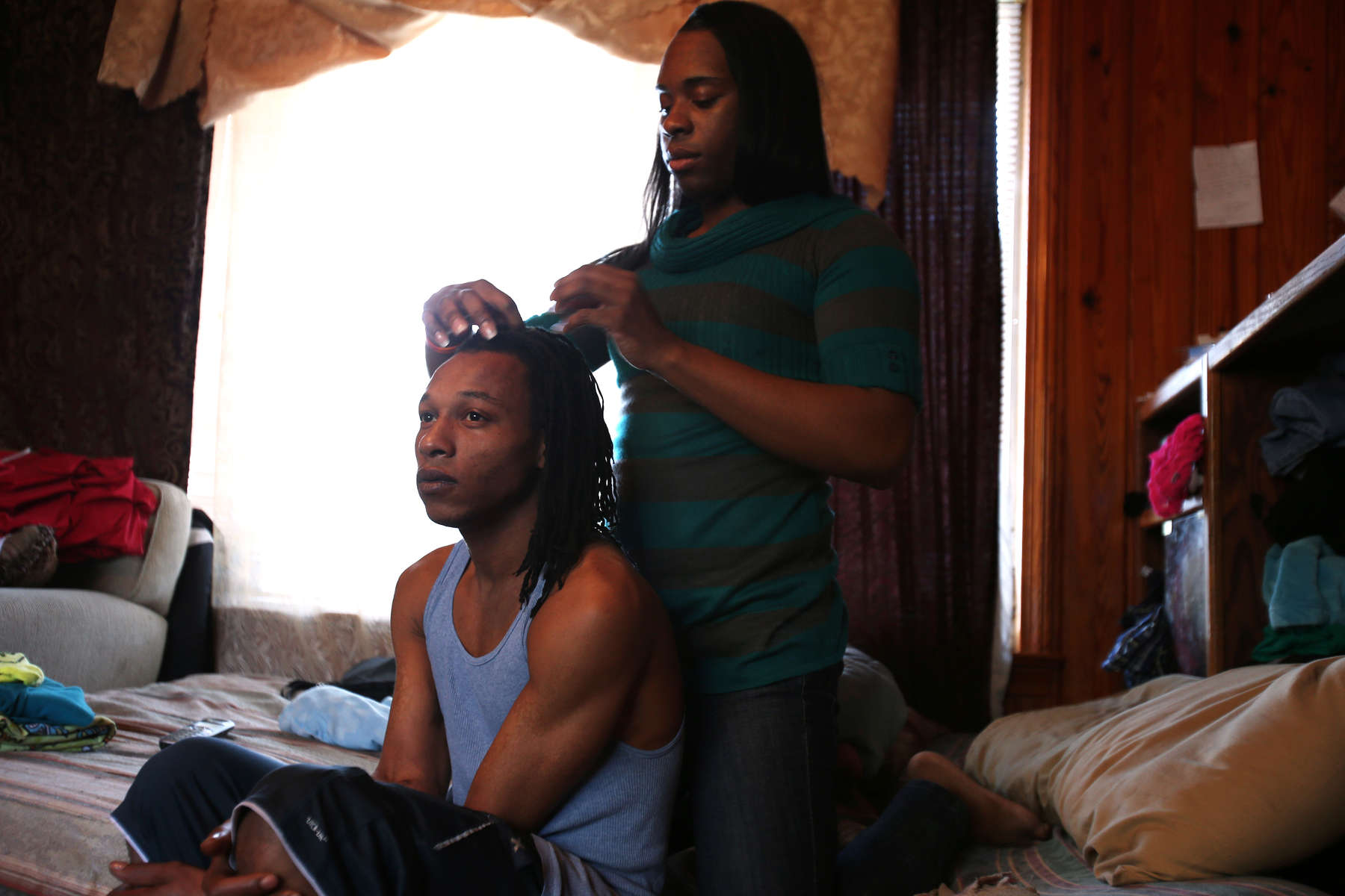 Timothy Smith and his boyfriend German Davis get ready for work at a Loxley Hardees in their Mobile home on Jan. 3, 2014. Timothy works as a cashier and German is a cook.