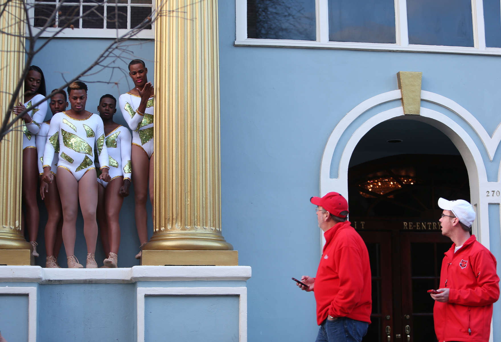 The Prancing Elites pose during a photo shoot with a local photographer on Dauphin Street in downtown Mobile.