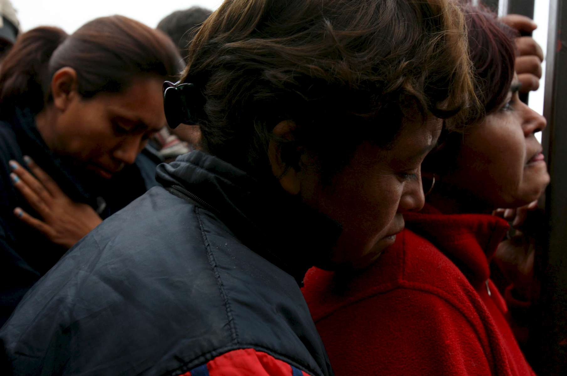 Women listen to a press conference given from behind the gates Thursday in front of the Pasta de Conchos coal mine in San Juan de Sabinas in the Mexican state of Coahuila Thursday. Family members waited outside the Pasta de Conchos coal mine Thursday. In the Early morning on Sunday 65 miners were trapped as much as 2000 feet below ground after an explosion. Sharón Steinmann / Houston Chronicle