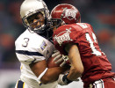 Rice receiver Toren Dixon (3) runs head on into Troy defender Elbert Mack (13) during the fourth quarter of the the Owls 41-17 loss to Troy University in the R+L Carriers New Orleans Bowl at the Louisiana Superdome, Friday, December 22, 2006.