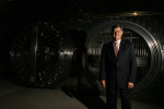 Chip Carlisle, president of the Texas region for Wells Fargo Bank, poses in front of the Wells Fargo vault in a tunnel below the Wells Fargo building on Louisiana Street in Houston. The old treasury vault was moved from Colorado in 1983. It weighs 22 tons and was built at the turn of the century in 1912.