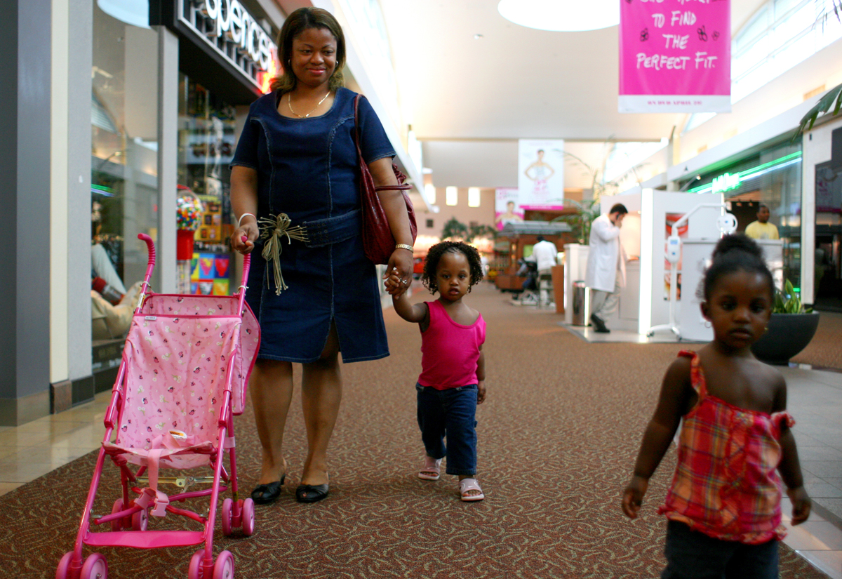 Celestina walks with the children of a friend through a mall in Sugarland, TX.
