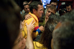 Henrique Capriles is greeted by supporters after conceding the election on Sunday night.