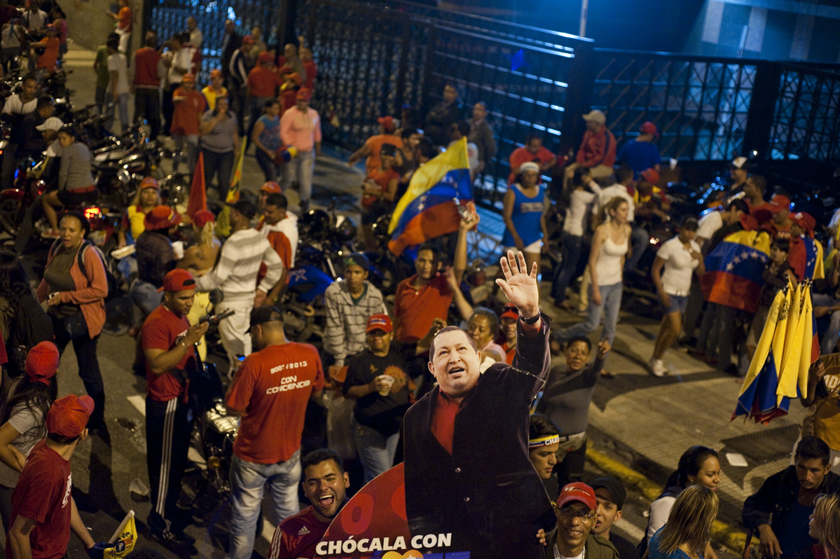 Thousands of Chavez supporters take to the streets in downtown Caracas to celebrate his re-election.