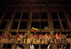 Chavez supporters cheer from a building as thousands took to the streets in downtown Caracas to celebrate his re-election.