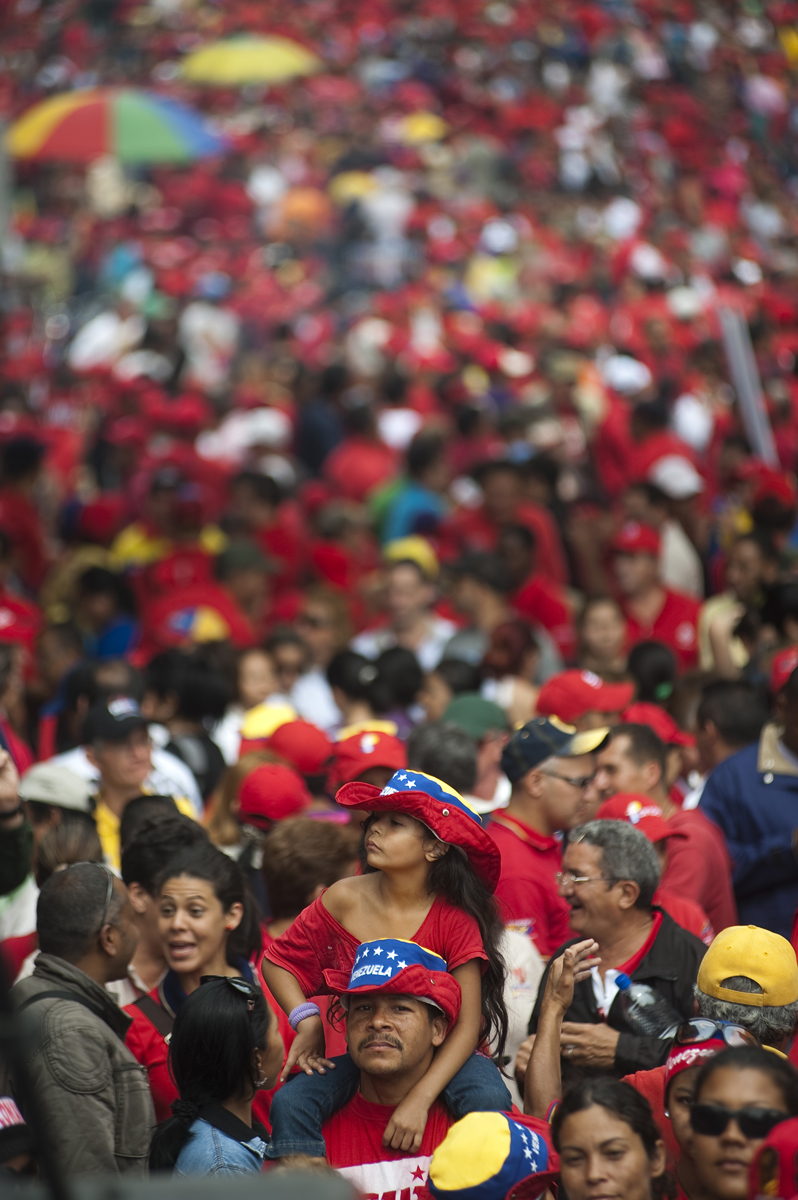 Hugo Chavez supporters rally outside Miraflores, the presidential palace, on Friday, April 13, 2012, in Caracas to celebrate the anniversary of Chavez's return to the presidency on April 13, 2002 after a failed coup.