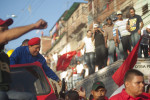 President Hugo Chavez greets his supporters during a rally in the Petare slum of Caracas, Venezuela as he celebrates his 58th birthday and continues his re-election campaign on Saturday, July 28, 2012. Petare is one of Latin America's largest and most violent slums.