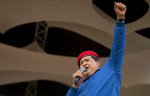 President Hugo Chavez speaks during a rally in the Petare slum of Caracas, Venezuela as he celebrates his 58th birthday and continues his re-election campaign on Saturday, July 28, 2012.