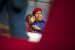 President Hugo Chavez hugs his daughter Rosines as he prepares to address his supporters during  a rally in the Petare neighborhood of Caracas, Venezuela on his 58th birthday on Saturday, July 28, 2012, in Caracas. He was in the middle of his  re-election campaign and had been battling cancer for over a year.