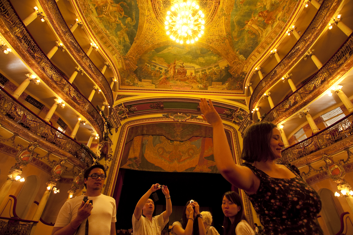 Tourists walk through the Teatro Amazonas opera house in Manaus which was built in the 1890s during the city's rubber boom.