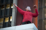 A chavez doll is seen on top of a building in downtown Caracas.