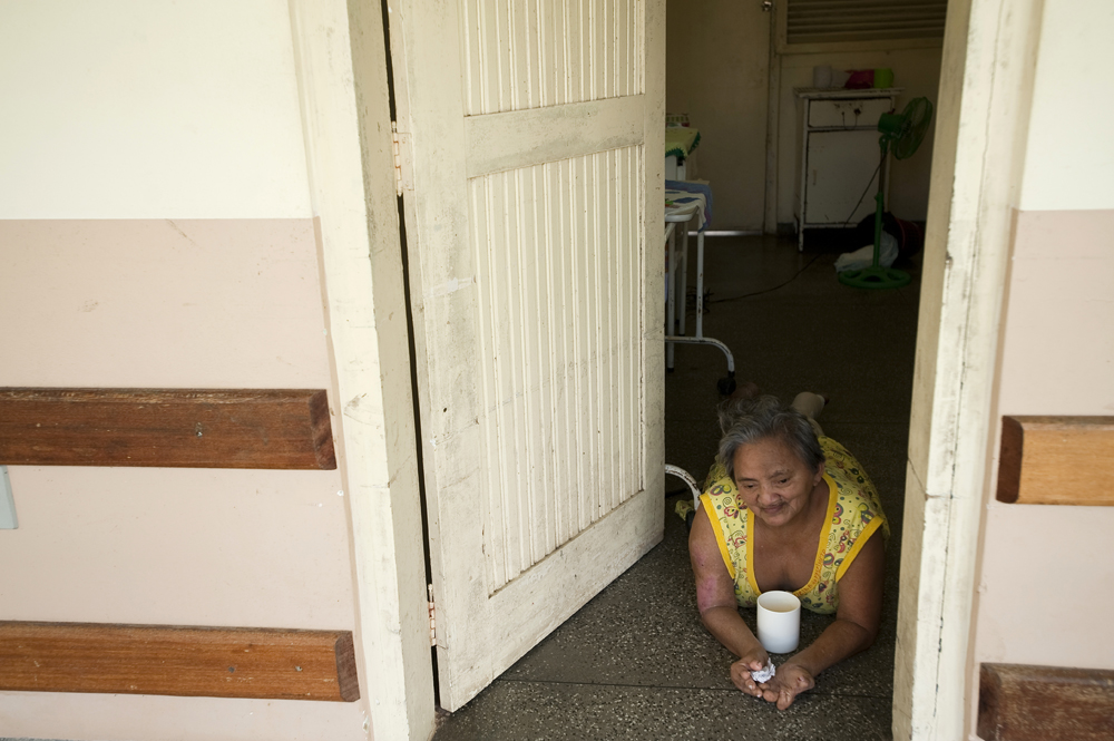 Lucia Alves Do Nascimento, 68, rests in the doorway of her room on Monday, March 12, 2012 in Manaus. She has lived in the leprosarium for the past 30 years.