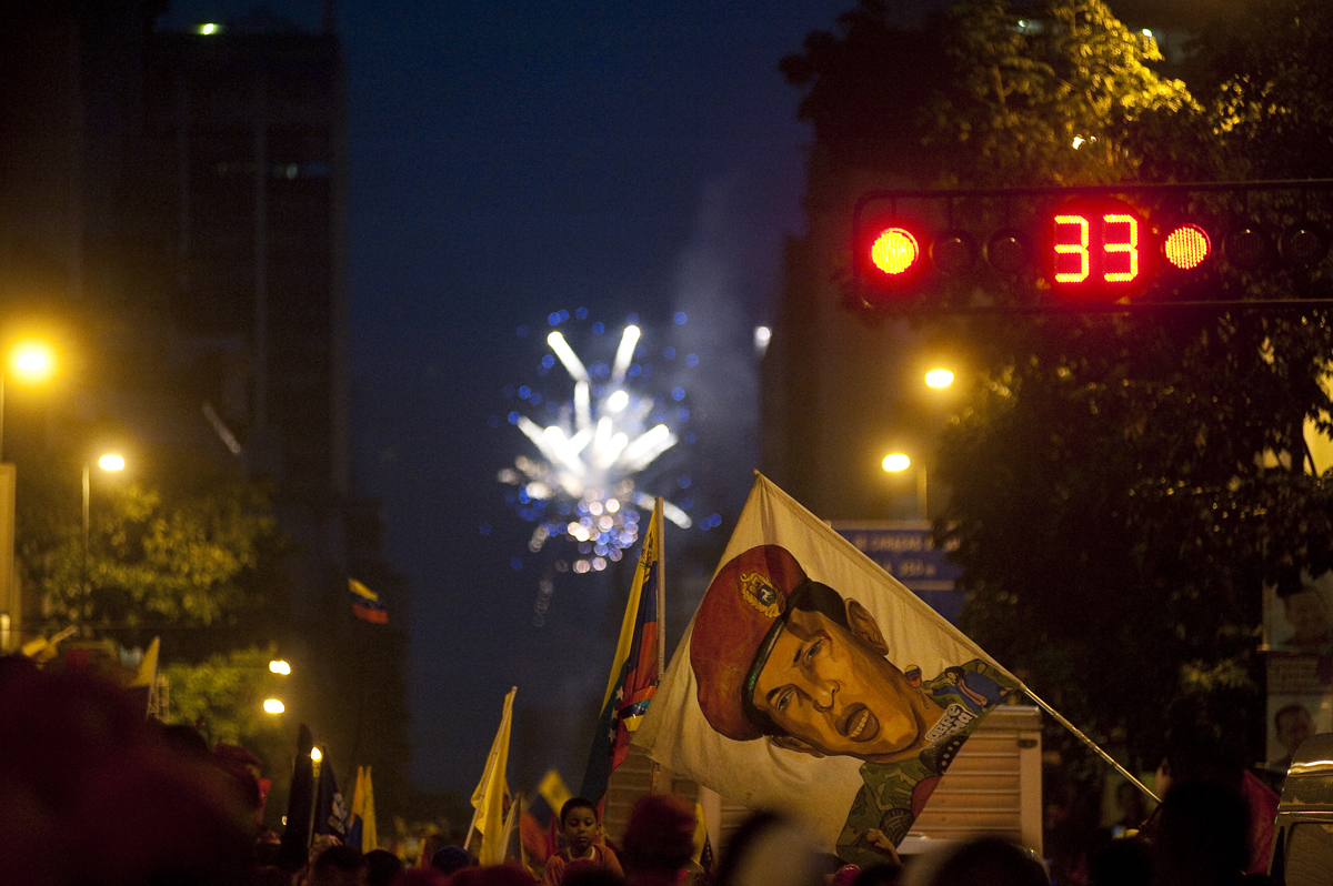 Hundreds gather in downtown Caracas, Venezuela during a celebration closing President  Hugo Chavez's re-election campaign on October 4, 2012. The elections were held three days later and Chavez, who is suffering from cancer, won a third term as president.