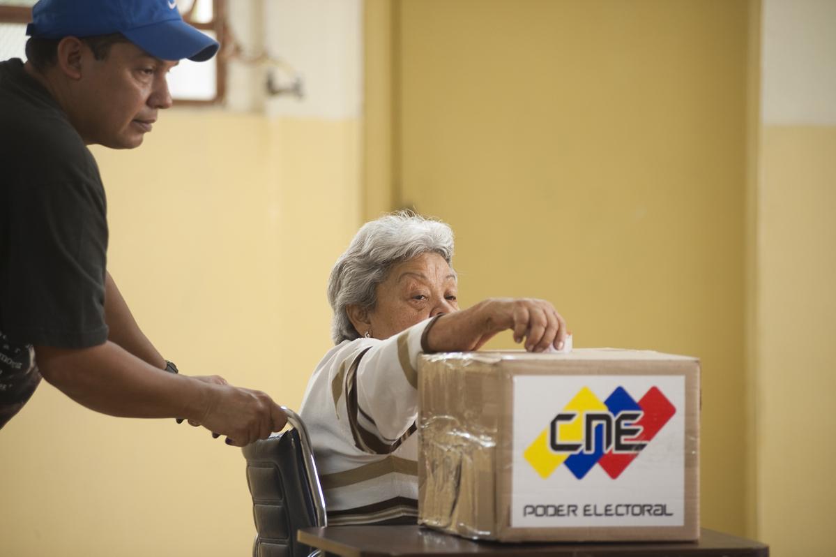 A woman in a wheelchair casts her vote in the 23 de Enero neighborhood in Caracas.