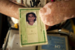 Maria Pereira Cavalcante, 49, holds her identity card. She came to the Antonio Aleixo leprosarium from a remote location in the Amazon.