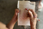 Dalila Matio, 81, stays alert by doing crossword puzzles on Monday, March 12, 2012. She was interned at the now defunct Paricatuba Leprosarium outside Manaus when she was 15 and moved to Colonia Antonio Aleixo in 1966. She met her husband at Paricatuba and they lived together at both leprosariums until they were permitted to leave the grounds for the first time in the late 1960s and live in their own house in the colonia. In 2008, they moved back into the leprosarium. Her husband passed away five years ago.