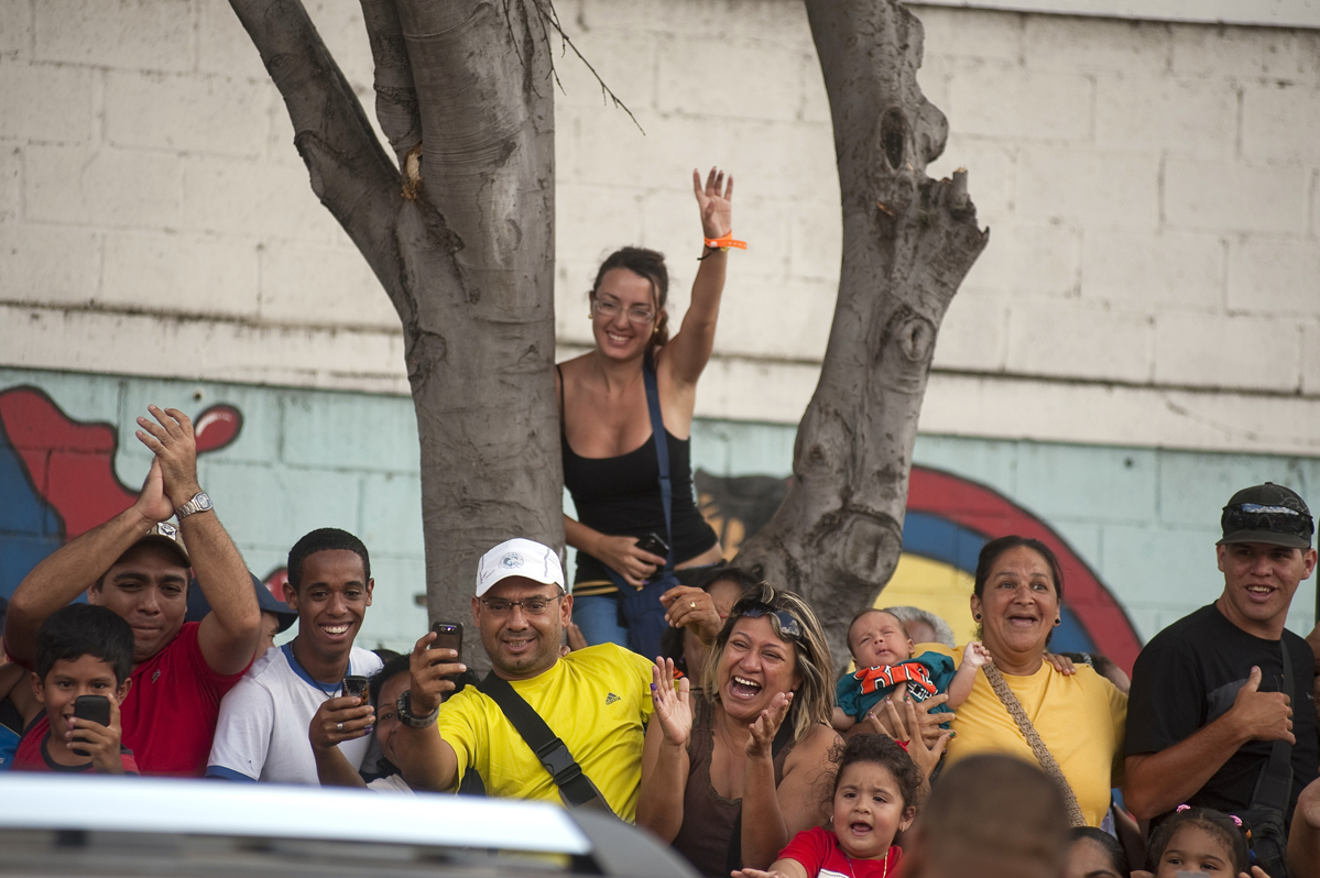 Supporters react as President Hugo Chavez arrives in an SUV to vote at a 23 de Enero neighborhood voting center.