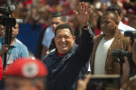 Hugo Chavez waves to fans as he arrives to vote at a voting center in the 23 de Enero neighborhood of Caracas.