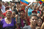 Chavez supporters wave as Hugo Chavez leaves a voting center in Caracas after casting his vote.