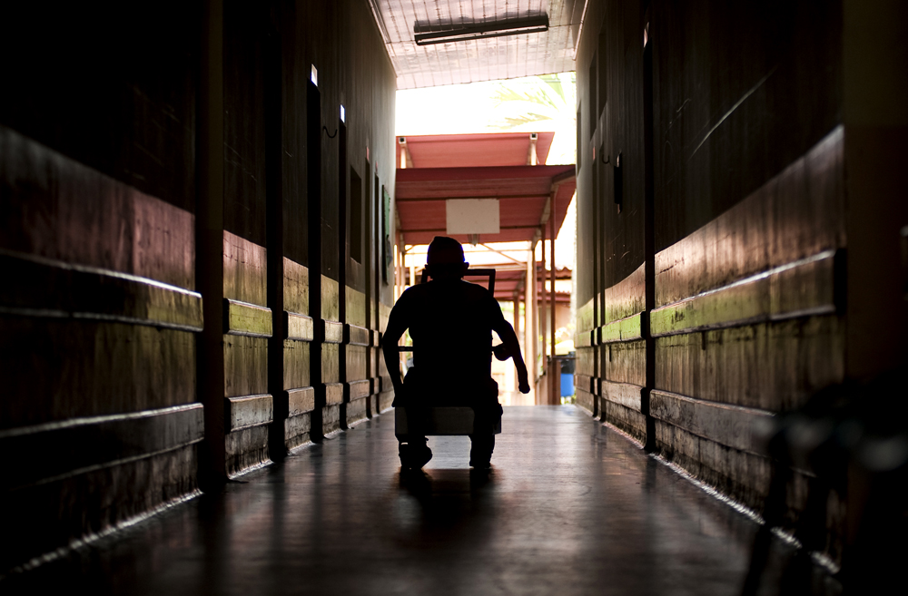 Anibal Rodriguez De Souza, 73, wheels his way down the hallway at the Antonio Aleixo leprosarium on Saturday, March 17, 2012 in Manaus. was interned at the Colonia Antonio Aleixo leprosarium in 1948 when he was 9-years-old. When he finally left in 1974, he managed to find work in sales, married and had three children. He has been back at the hospital for two months for treatment.