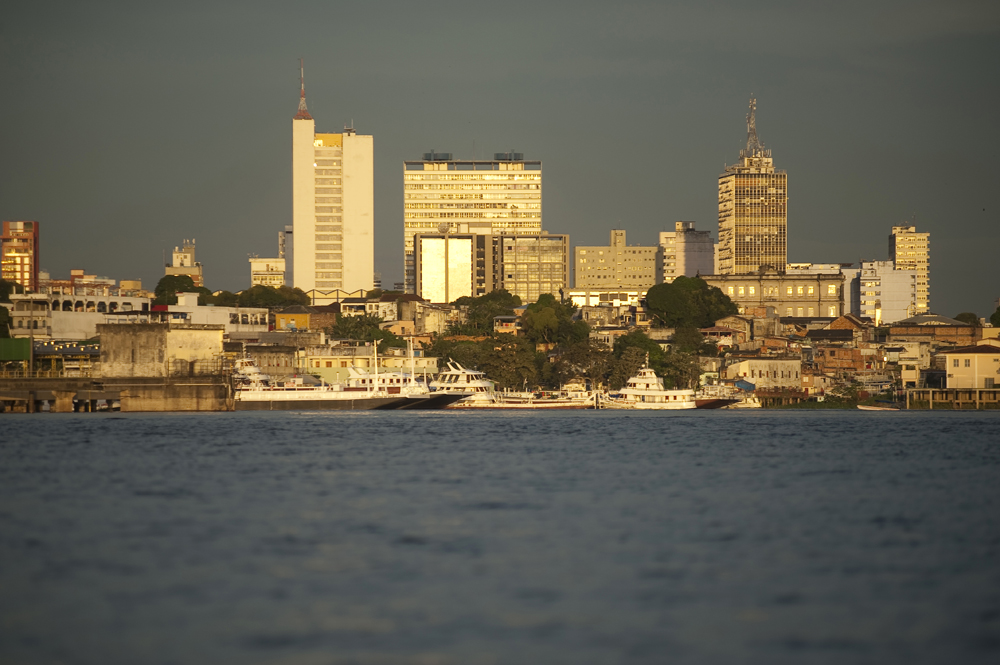 A view of the skyline of Manaus, Brazil from the Rio Negro. Manaus is a city in Northern Brazil that is expanding into its surrounding rain forest on Tuesday, March 13, 2012.