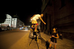 Sergio Bicudo of Manaus greets a passerby as he walks on stilts through St. Sebastian Square in Manaus, Brazil on Wednesday, March 14, 2012.