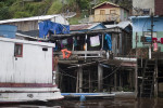 As Manaus becomes increasingly more urban, shantytowns are growing. People from small towns in the Amazon come to Manaus in search of work in the manufacturing sector. Photographed on Friday, March 16, 2012.